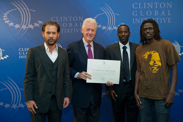 Emmanuel Jal with Bill Clinton